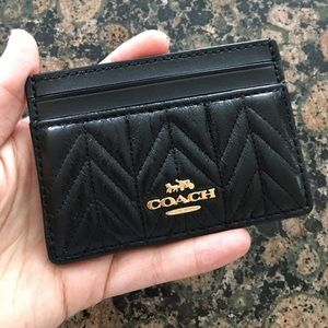 Authentic Coach leather skinny wallet